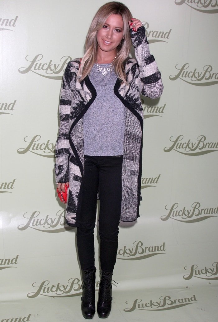 Ashley Tisdale wears a Lucky Brand Aztec drapey wrap sweater at the Lucky Brand flagship Store Opening