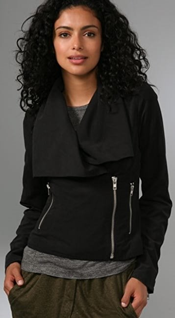 This jacket features an oversized shawl collar and an off-center, exposed zip at the front