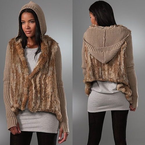 This pieced fur jacket features a waffle-knit hood and long sleeves