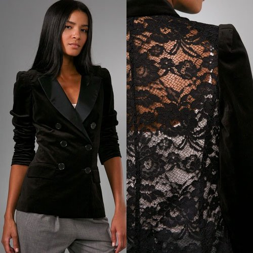 This double-breasted velvet jacket features a stand-up collar and a satin fold-over collar. 6-button closure and flap hip pockets