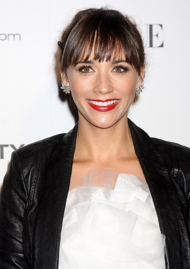 Rashida Jones styled a leather jacket with a light and frothy Marchesa dress