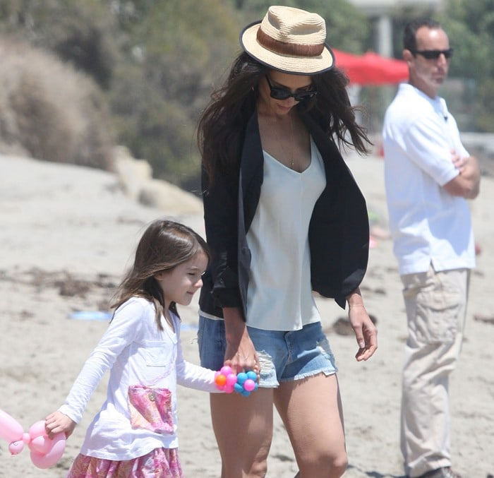 Katie Holmes with daughter Suri playing in the sand at a beach in Malibu