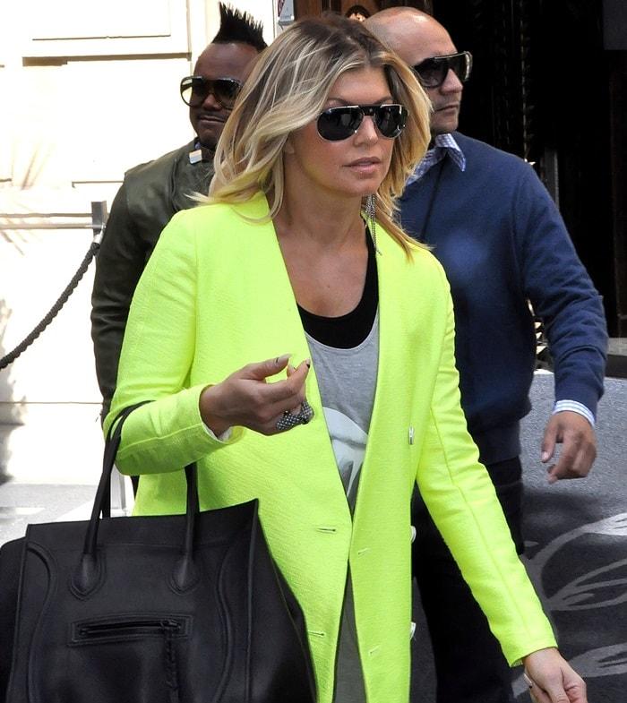 Fergie wearing a neon green sun-glaring collarless jacket
