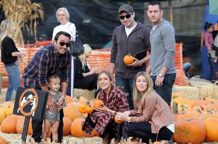 Kristin wore a geometric-printed, gray-and-maroon blanket cardigan to go pumpkin picking