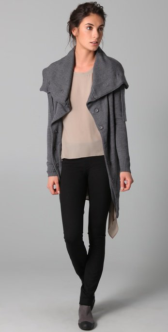 This wool cardigan sweater features a tie at the oversized, fold-over collar