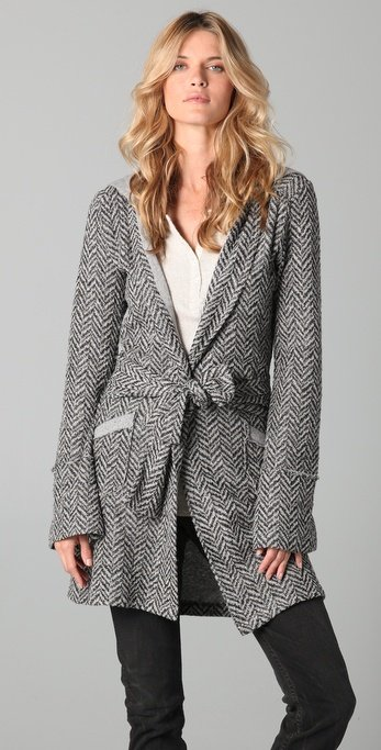 This hooded, knit jacket features an intarsia herringbone pattern