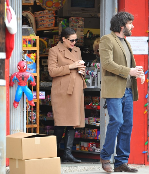 An expectant Jennifer Garner and husband Ben Affleck exiting a toy store while looking for Christmas presents for their daughters in Los Angeles on December 11, 2011