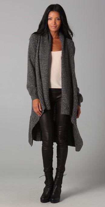 This oversized cardigan sweater features a shawl collar and an open placket