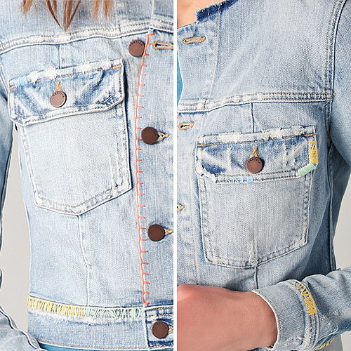This embroidered denim jacket features a crew neck and a 5-button closure