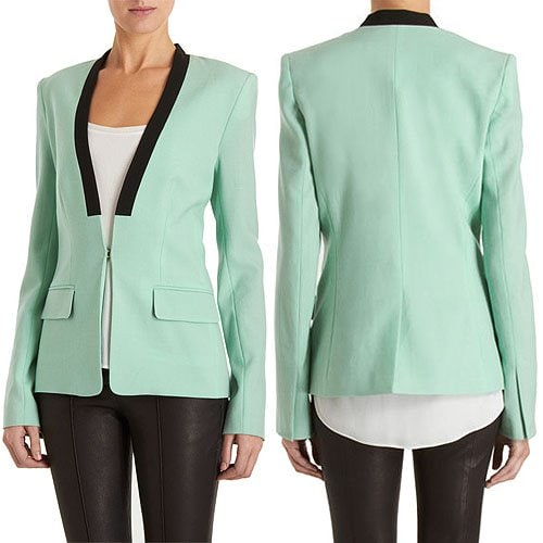 Blazer with mock lapel in a contrasting black color, flap pockets, and an interesting slit detail at the cuffs of the sleeves
