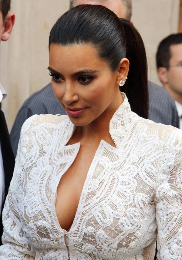 Kim Kardashian shows off her nipple pasties in an Alexander McQueen jacket