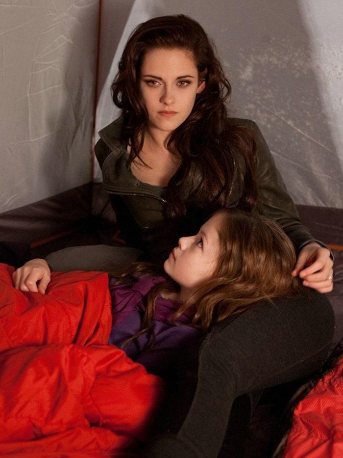Kristen Stewart as Bella Swan, posing with Renesmee, in a Belstaff double-breasted zip leather blazer jacket