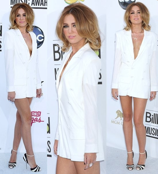 Miley Cyrus wearing nothing but a Jean Paul Gaultier jacket as a dress and Christian Louboutin heels