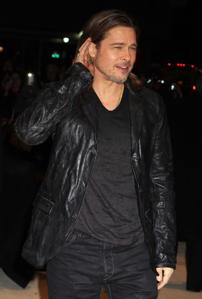 Brad Pitt casually posed for the cameras in his all-black ensemble, which he capped off with a wrinkled leather blazer.