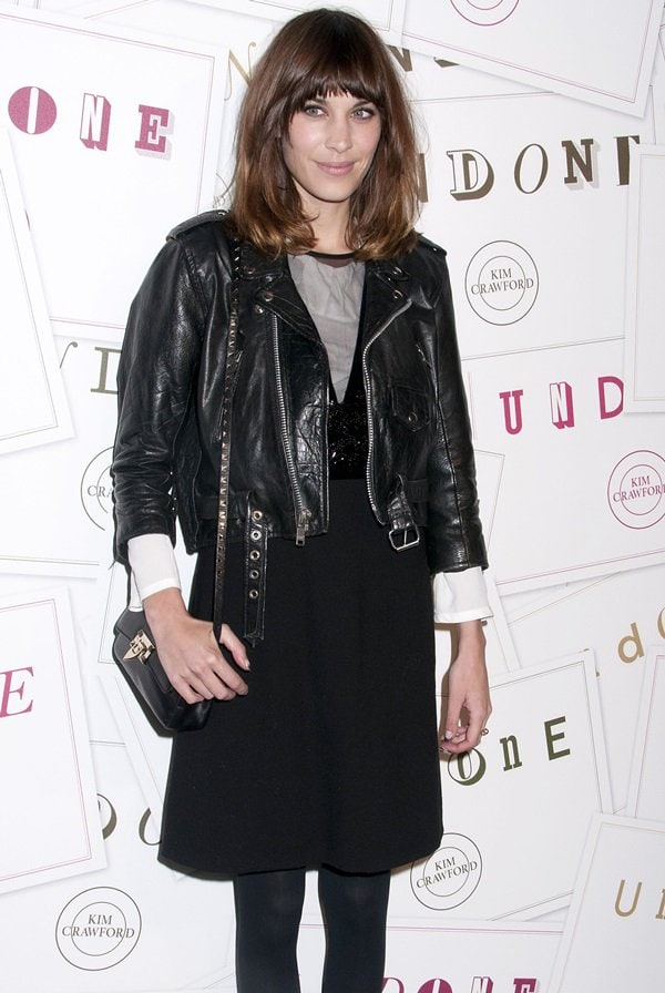 Alexa Chung shows how to pair a leather jacket with a matching dress