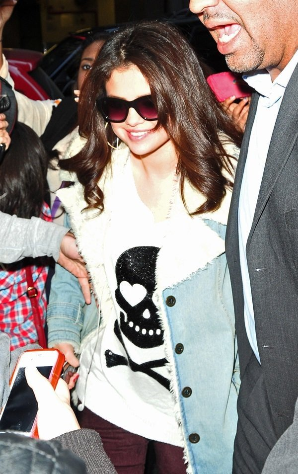 Selena Gomez was spotted in New York City wearing a denim and sherpa jacket from Free People