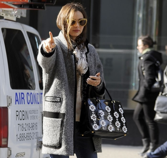 Australia's most searched celebrity Miranda Kerr hailing a taxi in an Isabel Marant Khan tweed coat