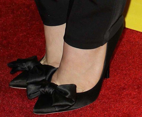 Chloe Moretz wearing bow-front Dolce & Gabbana satin heels