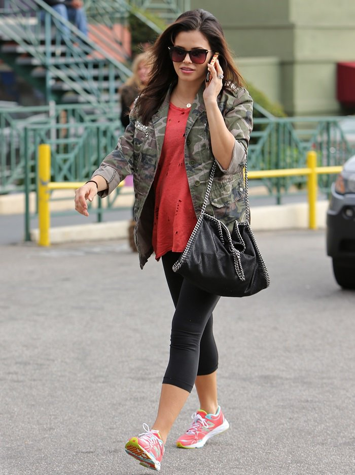 Jenna Dewan Tatum in a rocking casual ensemble consisting of an embellished camo jacket worn over a worn-out and distressed top
