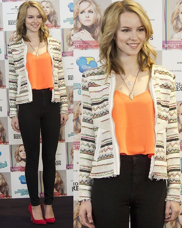 Bridgit Mendler looked brighter in an orange top, black jeans, red shoes, and a printed IRO Elomi jacket