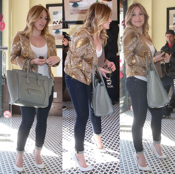Hilary Duff styled her jacket with a Celine 'Boston' tote in grey, Paige 'Verdugo' jeggings, and white Brian Atwood 'Starlet' pumps