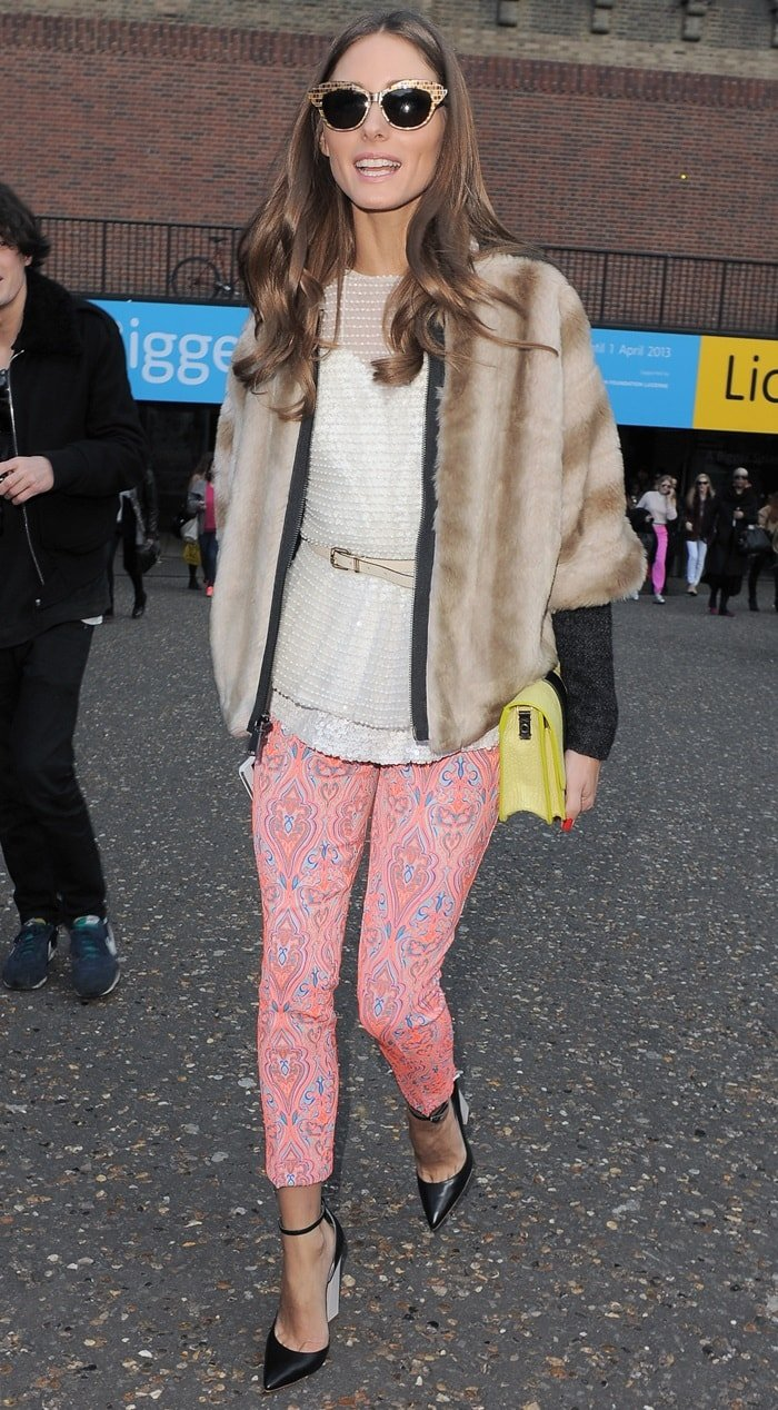Olivia Palermo rocked fun pink brocade-print pants with a sequin top from Topshop and a brown faux fur jacket from Tibi