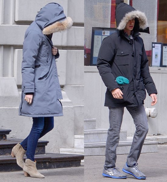 Andrew Garfield and Emma Stone using the hoods of their jackets to hide their faces from waiting photographers while out and about in New York City on March 3, 2013