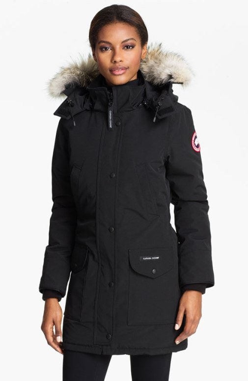 A cozy genuine coyote fur ruff trims the hood of a water-repellent parka cut for a shapely, flattering fit and filled with lofty duck down for reliable warmth without extra bulk