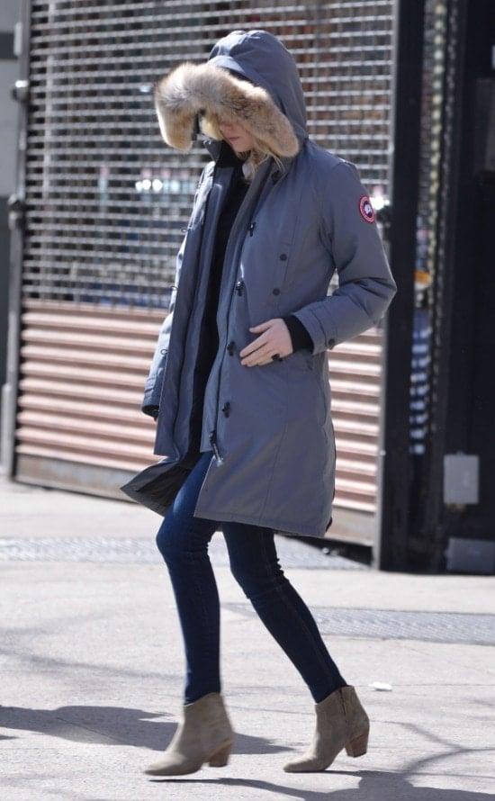 Emma Stone hid under a fur-trimmed Canada Goose jacket