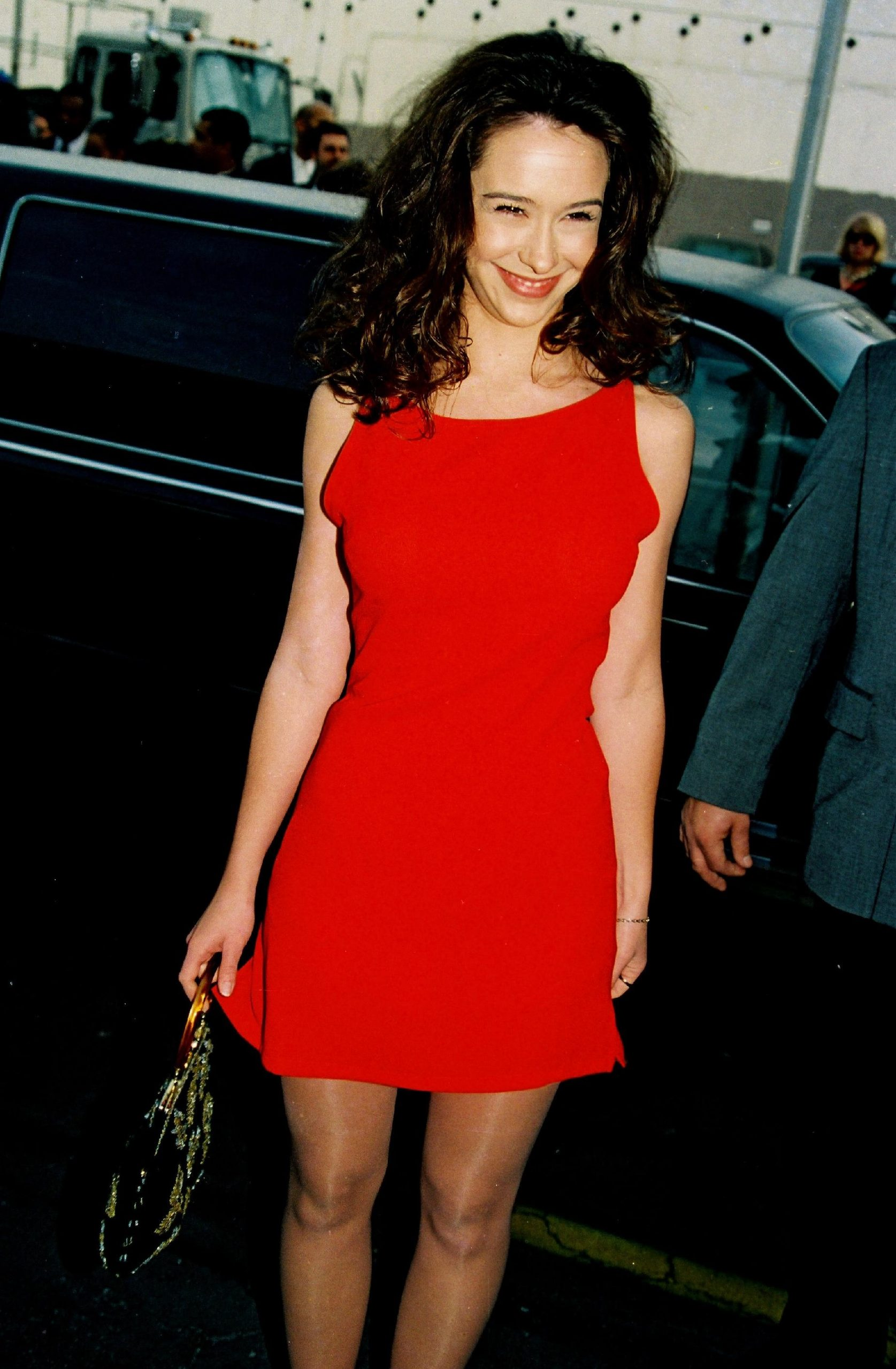 Sex symbol Jennifer Love Hewitt wears a red dress at the 23rd American Music Awards in 1996