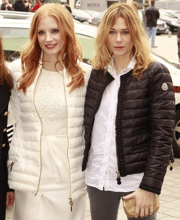 Marie-Josée Croze and Jessica Chastain attend the Moncler Gamme Rouge Fall/Winter 2013 Ready-to-Wear show as part of Paris Fashion Week on March 6, 2013, in Paris, France