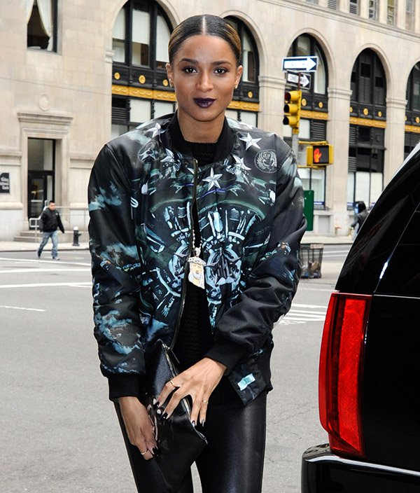 Ciara styled her jacket with a huge bling Jesus pendant necklace and leather pants