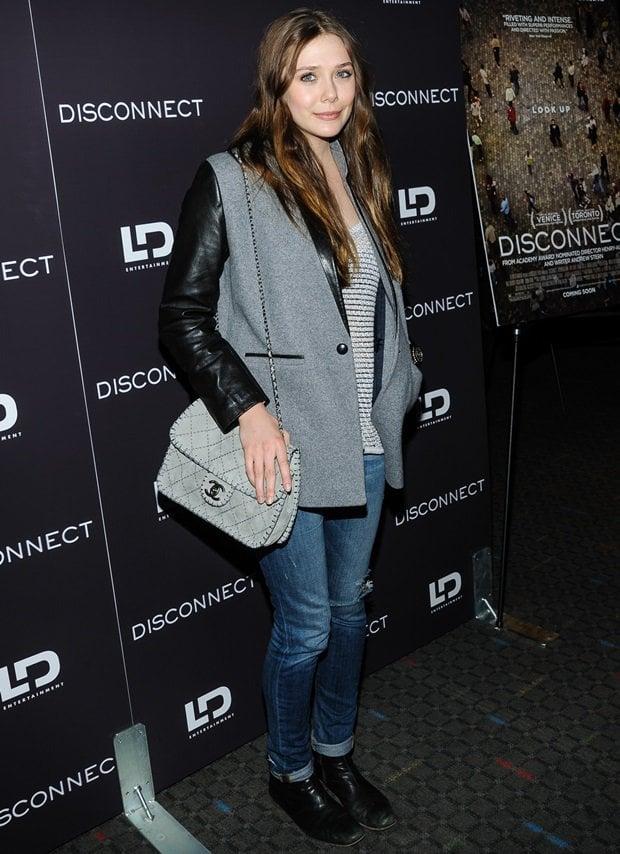 Elizabeth Olsen rocksslim denim pants, ankle boots, a Chanel shoulder bag, and a wool jacket