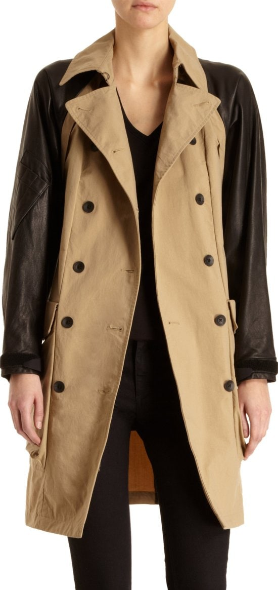 Soft leather sleeves temper the crisp texture of canvas, giving this trench a cool edge