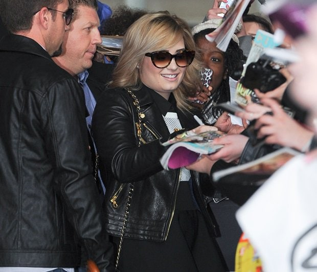 Demi Lovato attracts a large crowd of fans as she leaves BBC Radio 1 studios in London on May 29, 2013