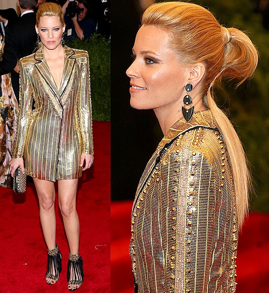 Elizabeth Banks wears a gold chainmail Versace jacket