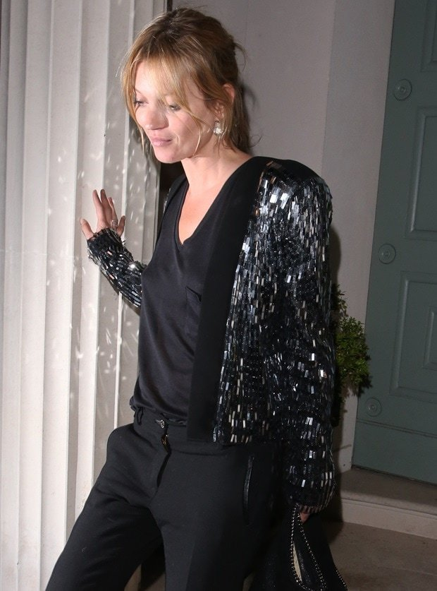 Kate Moss looking every inch a fashionista in her black and shimmering ensemble