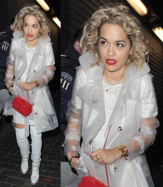 Rita Ora wearing a cropped plastic jacket