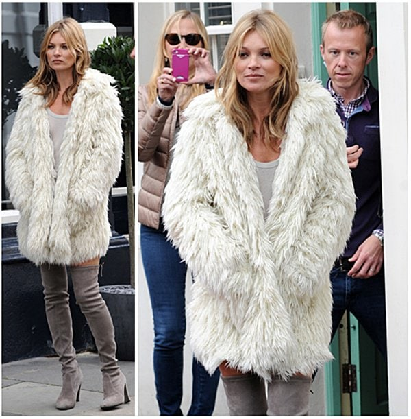 Kate Moss sporting a white faux fur jacket as she walked and posed for the cameras in the busy streets of London