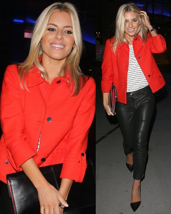 Mollie King's sleek skinny leather pants, black pumps, and striped top all looked chic, but it was her jacket that made her stand out