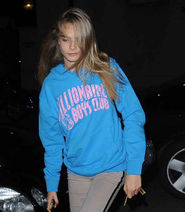 Cara Delevingne wearing a Pharrell Williams BBC jumper and arriving home at 5 a.m. from a dance studio in North London, United Kingdom, on July 22, 2013