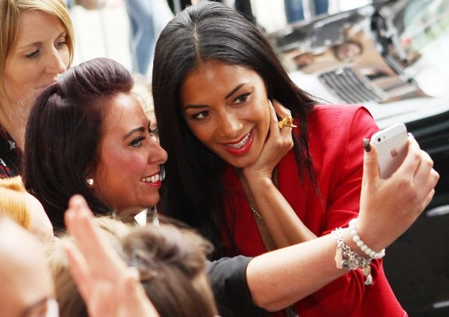 Nicole Scherzinger sharing a moment with fans at The X Factor audition in Cardiff, Wales, on July 3, 2013
