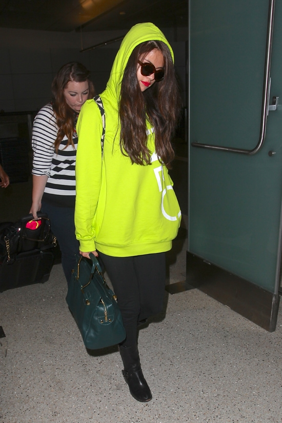 Selena Gomez arriving on a flight from Europe and accompanied by her bodyguard at LAX airport in Los Angeles, California, on July 10, 2013