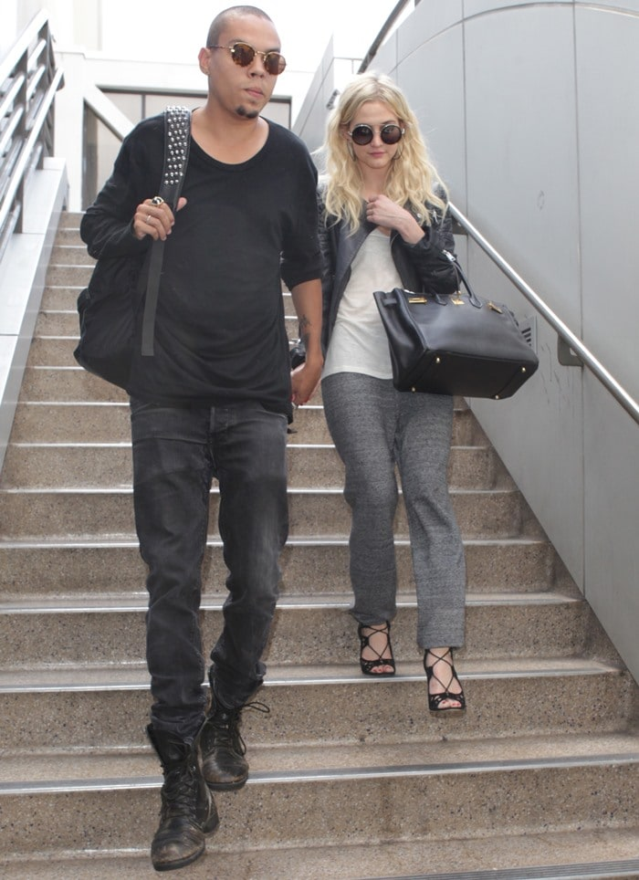 Ashlee Simpson and Evan Ross arrive together holding hands at LAX in Los Angeles, California, on July 31, 2013