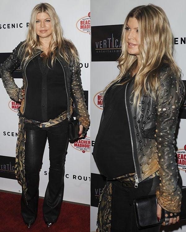 Fergie toting a black Perrin Paris Le Cabriolet clutch