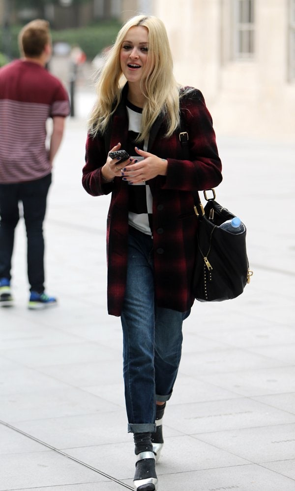 Fearne Cotton was definitely prepared for the bite in the air as she was wrapped up in a cozy-looking wool tartan coat