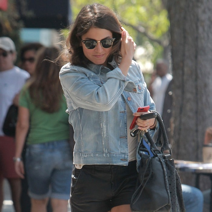 Nikki Reed wearing a denim jacket with leather hot pants in Los Angeles, California, on September 19, 2013