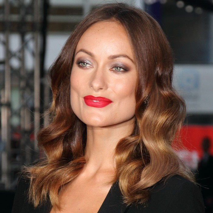 Olivia Wilde's wavy locks and bright red lipstick added allure to her already sexy outfit