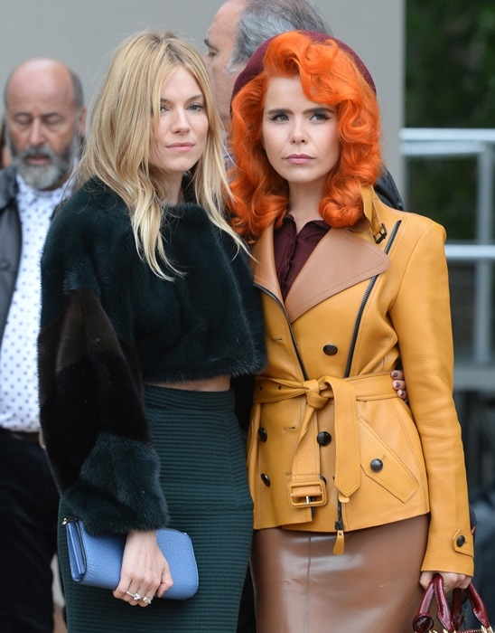 Talk about contrasts, here's Paloma's bright ensemble versus Sienna Miller's cropped fur top and striped skirt