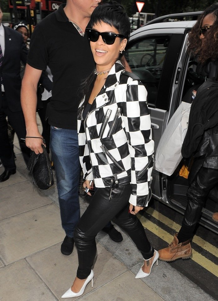 Rihanna accessorized with a choker necklace and dark sunglasses for a rock 'n roll appeal